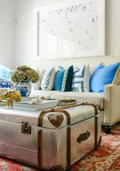 There are many things to love about this space, but our favorite is the converted trunk coffee table. It's great for small spaces because doubles for extra storage.