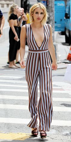 Emma Roberts Smolders in a Low-Cut Jumpsuit on the Streets of New York from InStyle.com