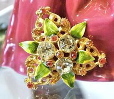 Hey, I found this really awesome Etsy listing at https://www.etsy.com/listing/246190535/1960s-60s-mid-century-brooch-rhinestone