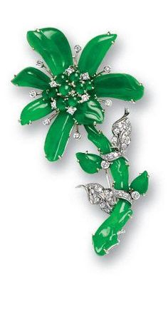 A jadeite and diamond brooch Of floral design, the cabochon jadeite and brilliant-cut diamond cluster surrounded by jadeite petals of highly translucent material, to jadeite stem and leaves highlighted by diamond leaves and collet-set diamonds, mounted in 18k white gold, length 6.8cm.