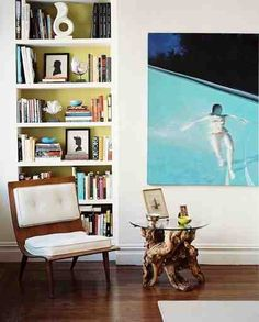 perfect bookcase styling and interior color.  Love that twisted teak wood root side table, and that chair.  Oh, the chair.  Victoria Thompson.