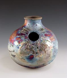 This is a DRUM. And it's Raku fired--oh for the day I'll be able to Raku too! Wistful sighs.