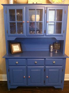 Refinished this old hutch, love the color.... Thinking about distressing it