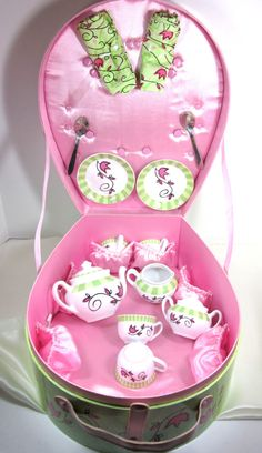 Oh I love this!  14 Piece tea set. Darling tea set for your little angel, In pretty pink and green. Originally this set was for four, but it is now a nice set for two with extra cups in case of breakage. Case and set is all in near mint condition. Manufactured out of Seattle WA. Measures, Case 14 tall 11 wide 6 deep