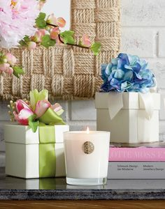 This luxury candle mingles aromatic jasmine and gardenia blooms with top notes of fresh bamboo for a calming floral fragrance. Arrives packaged in a decorative box with a silk flower topper that makes it the perfect gift for any occasion.