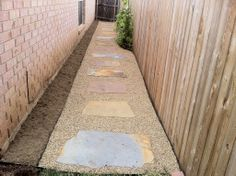 GroundScape, a Fort Worth Landscape Company, installs a natural pathway on the side of a house. Sprinkler System Repair, Flower Bed Edging, Drainage Solutions, Landscape Services, Landscaping Company, Outdoor Living Areas, Fort Worth, Pathways, Landscape Design