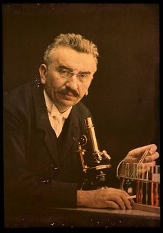 Louis Lumiere with microscope and test tubes, 1910