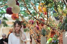 string lights on trees + colorful chinese lanterns