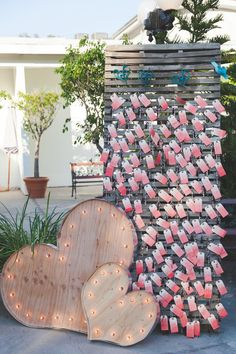 Ombre pink escort cards displayed next to rustic wooden hearts. Such a pretty welcome to the reception! {Abbey Lunt Photography}