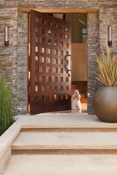 Check out this flattering take on pane windows, with small squares of amber glass embracing an open view without compromising security. This would be a nice door for an updated take on a classic exterior.