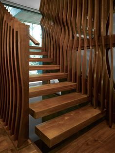 Layered undulating stair surround