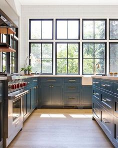 windows in kitchen and blue cabinetry