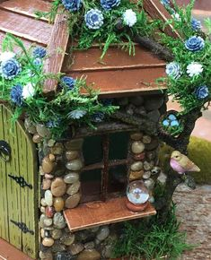 This whimsical little fairy house would be perfect for any fairy garden or placed in with a potted plant. It would also look nice in a childs room as a night light the sign above the faeries door says Dream At The Healers Garden we are dedicated to only the finest craftsmanship.
