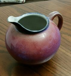 http://www.ebay.co.uk/itm/Rose-Pink-Blue-Fire-Glazed-Ball-Pottery-Pitcher-Signed-PLH-07-/252619627304?hash=item3ad14d9b28:g:cQEAAOSwXSJXO50p