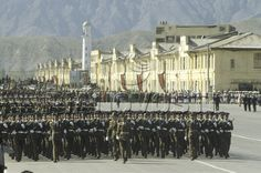 Officers and soldiers of the Afghan National Army marching past the Id Gah Mosque in Kabul at the 1988 Saur Revolution Day Parade.