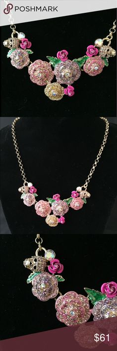 """🌸NWT 💀 Betsy Johnson Flower/ Skull Necklace 🌸CUTE! 💀 Betsy Johnson Flower/ Skull Necklace. Lots of stones.  5 Stoned Flowers. 4 Hot Pink Flowers. 2 Skulls. Approx 16"""" plus a 3"""" Extension. I also have matching Earrings! Betsey Johnson Jewelry Necklaces"""
