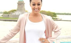 """How Tia Mowry Lost 20 Lbs. Dieting and Using Her Cookbook  Tia Mowry is showing off her trim figure thanks to her healthier-than-ever new diet. Earlier today the TV twin (and real life one too) posted a revealing pic of herself on Instagram wearing a baggy top and leggings. In the image the 38-year-old showed off her weight loss by pulling up her shirt and highlighting her tight tum. Along with the photo the actress/Cooking Channel star wrote """"I've lost 20 pounds! Many asked how? Diet and…"""