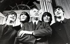 The fifth Beatle? Harold Wilson with the Fab Four in 1964. When he became prime minister, he proposed MBEs.