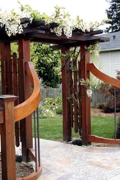 Cute for the opening in the backyard. Pergola and Curved Rail - RMGC Inc.