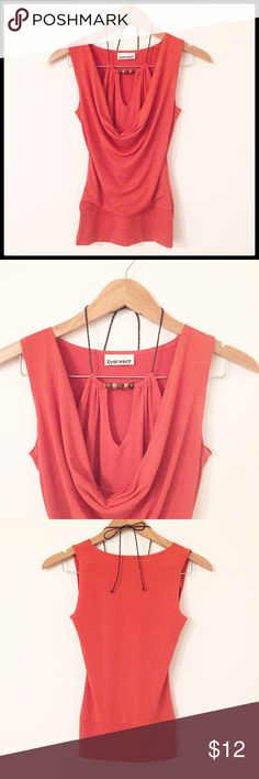 Byerwear Sleeveless Top Cute sleeveless top with layered look and keyhole cutout that ties around neck, has beadwork detailing for an added touch! Great top, great condition! Looks great with dress pants or skirt! Stretchy material, 92% polyester 8% spandex Byerwear Tops Tank Tops