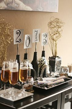 New Years Eve Party Ideas wine bottles with year as decor  we could set up a table like this! actually not that much work and really cute. I have those headbands already and my polka dotted wine glasses...