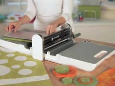▶ AccuQuilt GO! Fabric Cutter (55100) - YouTube - Any negative reiews. It looks like a faster way to cut out all those pieces!!