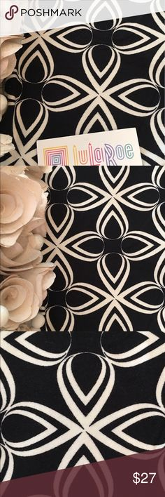 NWT LuLaRoe Black & White Teardrop Leggings OS Black and white patterns are hard to find in LuLaRoe leggings and these are gorgeous. NWT LuLaRoe Rare Black and White Teardrop Geometric Shape Leggings in OS. Simple and elegant pattern. Solid black leggings with white teardrop-shaped pattern. Your eye might see flowers or snowflakes or crosses or stars...that's the beauty with geometric patterns. I love the simply chic and clean feel of these. Made in China. 92% poly 8% spandex. I'm not a…