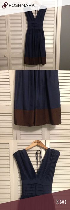 BCBG Silk Party Dress Perfect for your holiday parties, this navy BCBG  dress is sexy and sophisticated. The gorgeous pleated plunge v-neck gives it a Grecian feel, with a fit and flare skirt and sassy behind the back bow. Chocolate accent at the hem and back zipper. Just an elegant piece. 100% silk. Dry clean only. BCBGMaxAzria Dresses Midi
