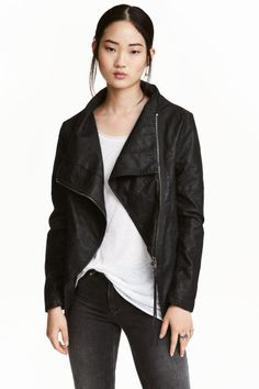 Biker jacket: Biker jacket in imitation leather with a diagonal zip at the front, ribbed jersey sections under the arms, and side pockets. Lined.