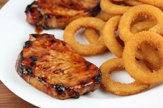 It's time to fire up the grill again for these Jack Daniel's grilled pork chops. The pork chops are marinated in a Jack Daniel's sauce and Bbq Pork Ribs, Pork Ham, Grilled Pork Chops, Grilled Meat, Pork Rib Recipes, Ham Recipes, Grill Recipes, Healthy Recipes, Spicy Chicken Sandwiches