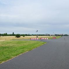 Walk along an authentic airplane runway at Tempelhofer Feld in Berlin, Germany.