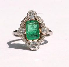 ANTIQUE EMERALD AND DIAMOND ENGAGEMENT RING. 2900