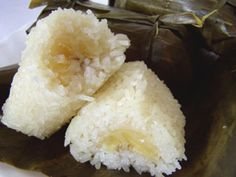 banana stuffed sweet coconut sticky rice  then wrapped and steamed in banana leaf - thai sweet.