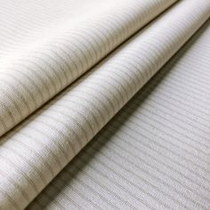 Curtain linings don't have to be plain! Lining Stripe Cream is a neutral cotton lining fabric that features multiple delicate-coloured pinstripes. With an extremely timeless yet simple design, it is perfect for adding a luxury finishing touch to any curtains or blinds. It will ensure that your curtains look as beautiful from outside your windows as they do from inside. This 100% cotton fabric is suitable for curtains, blinds and cushions. Cream Curtains, Curtains With Blinds, Curtain Lining Fabric, Lined Curtains, Striped Fabrics, Upholstered Furniture, Simple Designs, Neutral, Cotton Fabric