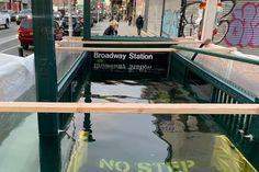 New York City commuters were perplexed by a submerged subway entrance Wednesday. The MTA was testing new equipment it installed to protect the subway from damaging floods and make its system more resilient to climate change. Metropolitan Transportation Authority, The Verge, Nyc Subway, Environmental Science, Train Travel, Public Transport, Planet Earth, Climate Change, New York City