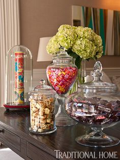 Oversize glass jars filled with movie theater are pretty to look at and provide a quick treat in the family room. - Photo: Michael Garland / Design: Chris Barrett