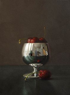 There are two paintings here: the still life itself and the miniature of the room, as it is reflected in the goblet's plump side. I believe ...