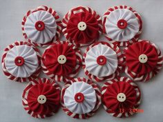 PEPPERMINT FABRIC YO YOS - 10 IN TOTAL  You will receive 10 yo yo ornaments.  Background 2 yo yo in red/white peppermint stripe.  Top yo yo (5 in white, 5 in red) measures 1 1/2.  The two yo yos are sandwiched together with a red or white button.  Hand sewn with double thread for durability. These yo yos would make lovely Christmas decorations - simply add a string, or on a tag.  Made from quality cotton fabric.  Please feel free to contact me for a shipping quote should you wish to...