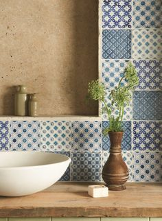 A mix of patchwork blue and white tiles. Handmade patterned ceramic tiles from the Chateaux collection by The Winchester Tile Company. winchestertiles.com