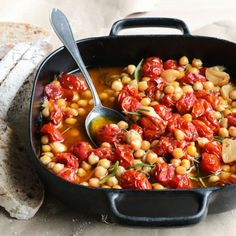 Slow braising in olive oil turns cherry tomatoes, garlic, and chickpeas into flavorful, mellow stew. Enjoy with the fresh bread! Vegan