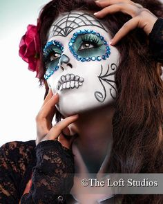 Dia de Los Muertos Sugar Skull make-up mask accented with aqua crystals.