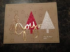Stampin' Up! ... handmade Christmas card ... threetrianble trees punched from glimmer paper ...   Old Fashioned by Lmaco ... kraft  base with embossing folder stars lightly inked ... JOY die cut from gold ... luv the contrast of country and glitz ...