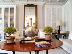 To hide the disparate pattern of books in the library Stephen Sill's lined his glass-fronted bookcases with bamboo shades painted white.