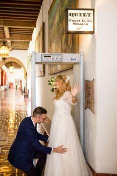 Groom frisking his bride at Santa Barbara Courthouse