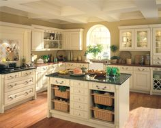 this layout looks a lot like my current kitchen.... love the cabinets...