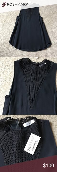 A.L.C. Black and Navy High Neck Blouse A.L.C. high neck blouse - navy silk tank blouse with black crochet illusion detail at the neck. Elegant and versatile. Women's size 2. New with tag. A.L.C. Tops Blouses