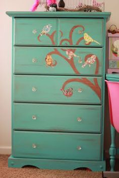 "Little Girls bird distressed dresser. :)  We painted it, distressed it, glazed it, and ""vinyled"" it with Bird decals from Amazon.com!"
