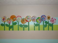 Coffee filter flower garden...like the idea of doing a display like this over my lockers...hmmm...tack up a long strip of bulletin board paper as a background, then add the flowers? Or whatever we want to make a display of? I think I am digging this idea...