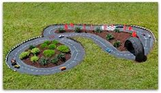 Make a race car track.  - We used this idea and created one in our memorial garden for our lil' grandson.  It's such a joy to see our other grandchildren playing in his garden.  We know he would have loved the race track as much as they do.