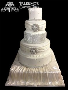 White Weddng Cake with crystals  Palermo's Bakery creates custom cakes, wedding cakes, birthday cakes, graduation cakes, cake pops, cupcakes, cookies, custom dessert tables and serves the New Jersey/New York Area.